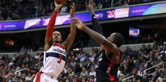 Nov 2, 2016; Washington, DC, USA; Washington Wizards guard Bradley Beal (3) shoots the ball over Toronto Raptors forward Patrick Patterson (54) in the fourth quarter at Verizon Center. The Raptors won 113-103. Mandatory Credit: Geoff Burke-USA TODAY Sports