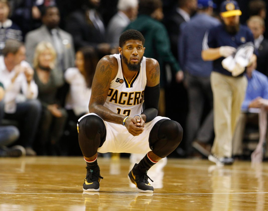 Nov 5, 2016; Indianapolis, IN, USA; Indiana Pacers forward Paul George (13) watches as the Pacers shoot a free throw against the Chicago Bulls at Bankers Life Fieldhouse. Indiana defeats Chicago 111-94. Mandatory Credit: Brian Spurlock-USA TODAY Sports