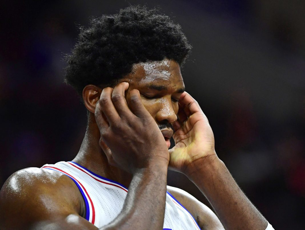 Nov 7, 2016; Philadelphia, PA, USA; Philadelphia 76ers center Joel Embiid (21) reacts after being hit in the head against the Utah Jazz during the second half at Wells Fargo Center. The Jazz defeated the 76ers 109-84. Mandatory Credit: Eric Hartline-USA TODAY Sports