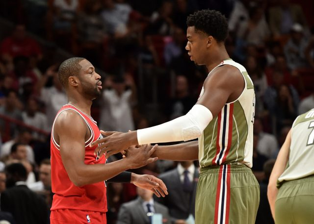 Nov 10, 2016; Miami, FL, USA; Chicago Bulls guard Dwyane Wade (3) greets Miami Heat center Hassan Whiteside (21) during the first half at American Airlines Arena. Mandatory Credit: Steve Mitchell-USA TODAY Sports