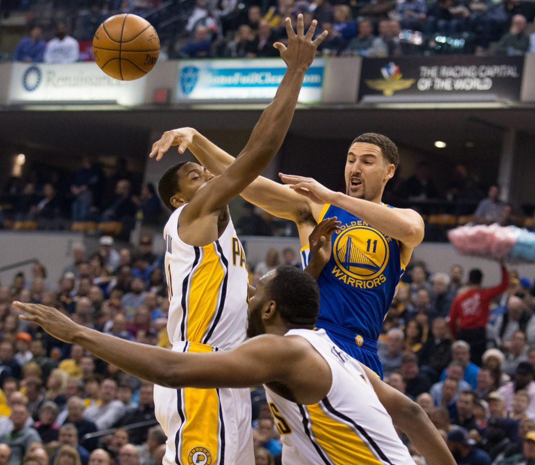Nov 21, 2016; Indianapolis, IN, USA; Golden State Warriors guard Klay Thompson (11) passes the ball as Indiana Pacers guard Glenn Robinson III (40) defends in the first half of the game at Bankers Life Fieldhouse. Mandatory Credit: Trevor Ruszkowski-USA TODAY Sports