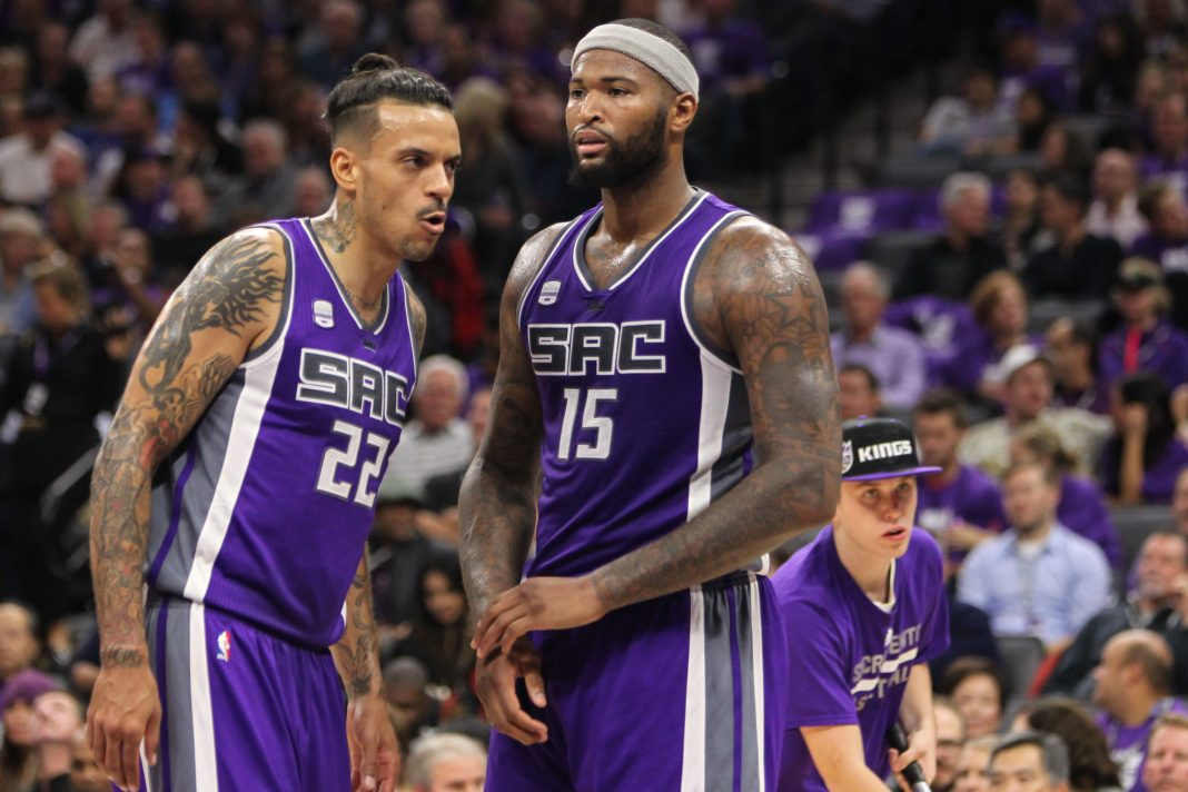 Oct 27, 2016; Sacramento, CA, USA; Sacramento Kings forward Matt Barnes (22) talks with center DeMarcus Cousins (15) at Golden 1 Center. The Spurs won the game 102-94. Mandatory Credit: Sergio Estrada-USA TODAY Sports