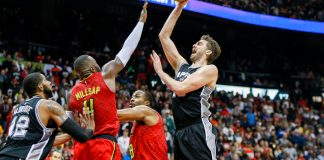 Jan 1, 2017; Atlanta, GA, USA; San Antonio Spurs center Pau Gasol (16) shoots the ball against the Atlanta Hawks in overtime at Philips Arena. The Hawks won 114-112 in overtime. Mandatory Credit: Brett Davis-USA TODAY Sports