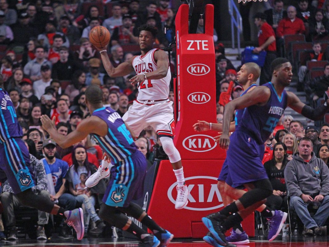 Jan 2, 2017; Chicago, IL, USA; Chicago Bulls forward Jimmy Butler (21) passes the ball during the first quarter against the Charlotte Hornets at the United Center. Mandatory Credit: Dennis Wierzbicki-USA TODAY Sports