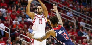 Jan 2, 2017; Houston, TX, USA; Houston Rockets guard Eric Gordon (10) shoots the ball during the second quarter as Washington Wizards forward Kelly Oubre Jr. (12) defends at Toyota Center. Mandatory Credit: Troy Taormina-USA TODAY Sports