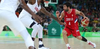 Aug 12, 2016; Rio de Janeiro, Brazil; Serbia point guard Milos Teodosic (4) works around United States defense during the game in the preliminary round of the Rio 2016 Summer Olympic Games at Carioca Arena 1. Mandatory Credit: Jason Getz-USA TODAY Sports