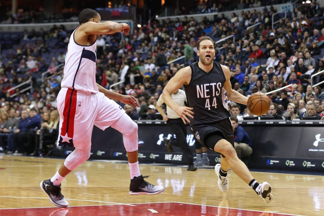 Dec 30, 2016; Washington, DC, USA; Brooklyn Nets guard Bojan Bogdanovic (44) drives to the basket as Washington Wizards forward Otto Porter Jr. (22) defends in the third quarter at Verizon Center. The Wizards won 118-95. Mandatory Credit: Geoff Burke-USA TODAY Sports