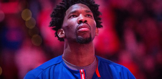 Jan 13, 2017; Philadelphia, PA, USA; Philadelphia 76ers center Joel Embiid (21) stands for the anthem prior to the start of a game against the Charlotte Hornets at Wells Fargo Center. Mandatory Credit: Bill Streicher-USA TODAY Sports