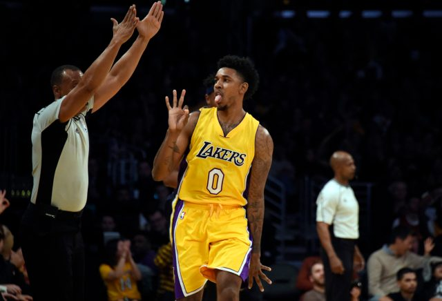 Jan 20, 2017; Los Angeles, CA, USA; Los Angeles Lakers guard Nick Young (0) reacts after a basket during the second quarter against the Indiana Pacers at Staples Center. Mandatory Credit: Richard Mackson-USA TODAY Sports