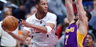 Jan 25, 2017; Portland, OR, USA; Portland Trail Blazers guard Evan Turner (1) passes around Los Angeles Lakers forward Larry Nance Jr. (7) during the third quarter at the Moda Center. Mandatory Credit: Craig Mitchelldyer-USA TODAY Sports