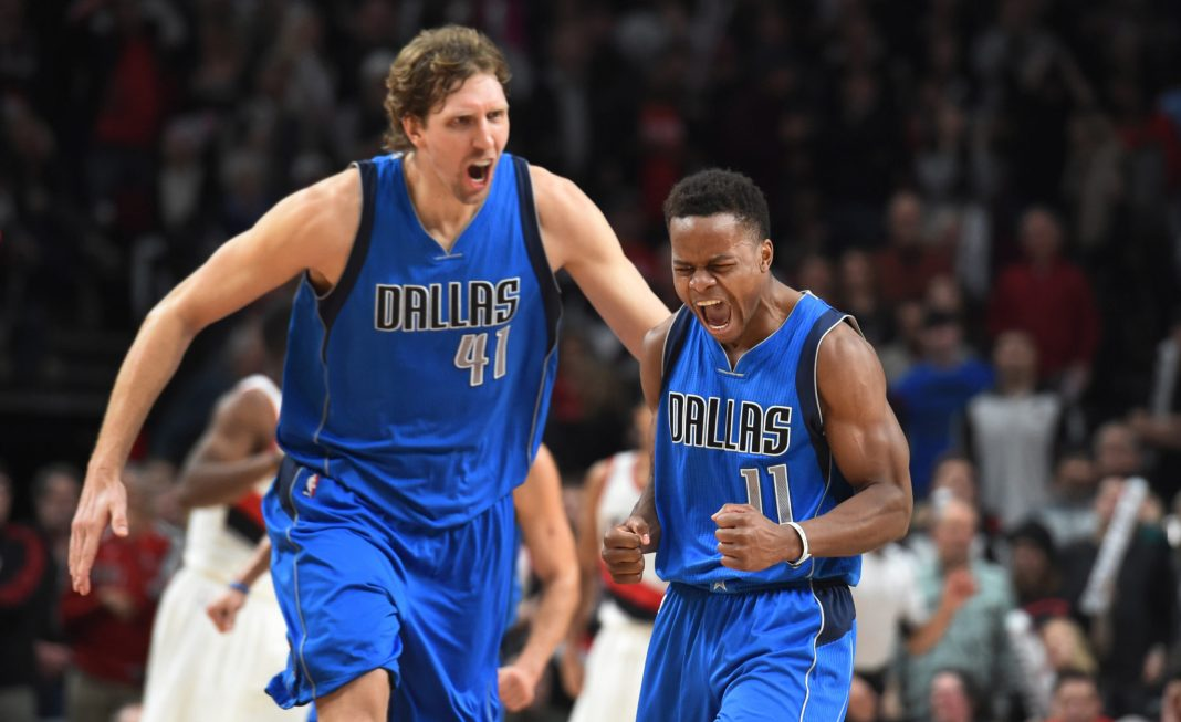 Feb 3, 2017; Portland, OR, USA; Dallas Mavericks guard Yogi Ferrell celebrates with forward Dirk Nowitzki after hitting a shot late in the fourth quarter of the game against the Portland Trail Blazers at the Moda Center. Dallas won the game 108-104. Mandatory Credit: Steve Dykes-USA TODAY Sports