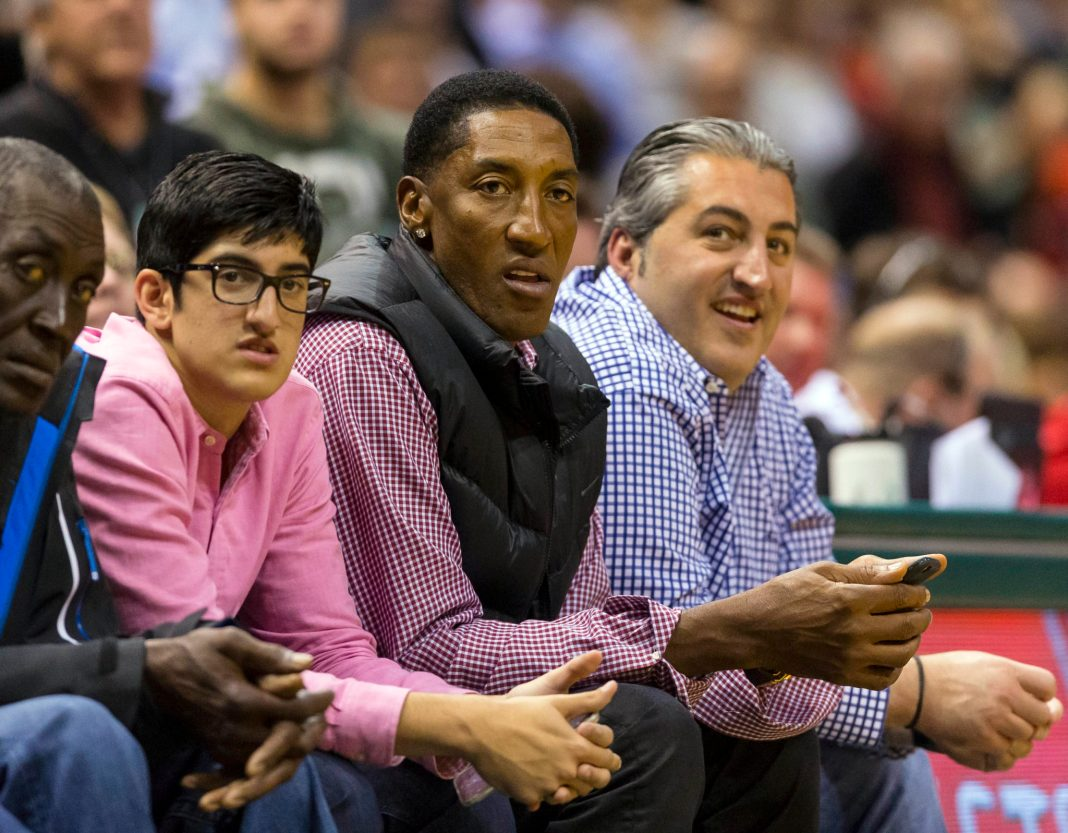 Apr 23, 2015; Milwaukee, WI, USA; Chicago Bulls former player Scottie Pippen (center) looks on during the fourth quarter in game three of the first round of the NBA Playoffs game between the Chicago Bulls and Milwaukee Bucks at BMO Harris Bradley Center. Mandatory Credit: Jeff Hanisch-USA TODAY Sports