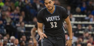 Mar 10, 2017; Minneapolis, MN, USA; Minnesota Timberwolves center Karl-Anthony Towns (32) reacts after making a three point shot in the first quarter against the Golden State Warriors at Target Center. Mandatory Credit: Jesse Johnson-USA TODAY Sports