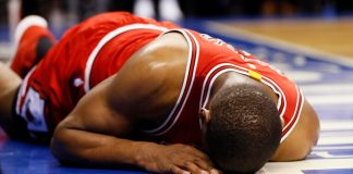 Mar 21, 2017; Toronto, Ontario, CAN; Chicago Bulls forward Cristiano Felicio (6) lies on the court after falling after a shot against the Toronto Raptors at the Air Canada Centre. Toronto defeated Chicago 122-120 in overtime. Mandatory Credit: John E. Sokolowski-USA TODAY Sports