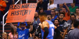 Apr 7, 2017; Phoenix, AZ, USA; A fan holds a sign for Oklahoma City Thunder guard Russell Westbrook recognizing him averaging a triple double for the season against the Phoenix Suns in the second half at Talking Stick Resort Arena. The Suns defeated the Thunder 120-99. Mandatory Credit: Mark J. Rebilas-USA TODAY Sports