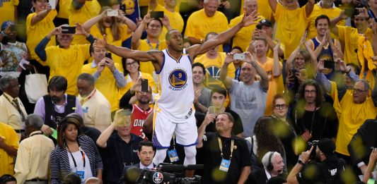 Jun 12, 2017; Oakland, CA, USA; Golden State Warriors forward Andre Iguodala (9) celebrates with fans in the stands after defeating the Cleveland Cavaliers in game five of the 2017 NBA Finals at Oracle Arena. Mandatory Credit: Kyle Terada-USA TODAY Sports