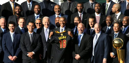 Nov 10, 2016; Washington, DC, USA; President Barack Obama (M) poses holding a gift jersey with Vice President Joe Biden (M-L) and members of the Cleveland Cavaliers at an event honoring the 2016 NBA world champion Cavaliers on the South Lawn at the White House. Mandatory Credit: Geoff Burke-USA TODAY NETWORK