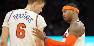 Dec 9, 2016; Sacramento, CA, USA; New York Knicks forward Carmelo Anthony (7) talks with forward Kristaps Porzingis (6) during the second half at Golden 1 Center. The Knicks defeated the Kings 103-100. Mandatory Credit: Sergio Estrada-USA TODAY Sports