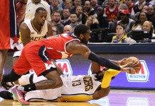 Feb 16, 2017; Indianapolis, IN, USA; Indiana Pacers forward Paul George (13) scrambles for a loose ball against Washington Wizards guard John Wall (2) at Bankers Life Fieldhouse. Washington defeats Indiana 111-98. Mandatory Credit: Brian Spurlock-USA TODAY Sports