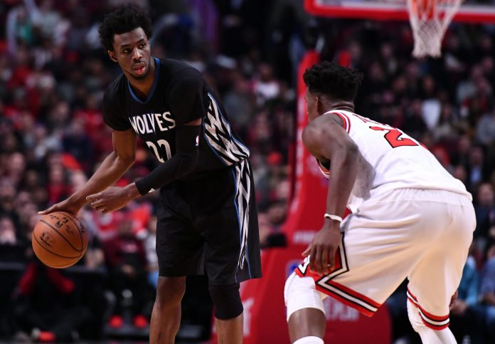 Dec 13, 2016; Chicago, IL, USA; Minnesota Timberwolves forward Andrew Wiggins (22) dribbles the ball against Chicago Bulls forward Jimmy Butler (21) during the second half at the United Center. Minnesota defeats Chicago 99-94. Mandatory Credit: Mike DiNovo-USA TODAY Sports