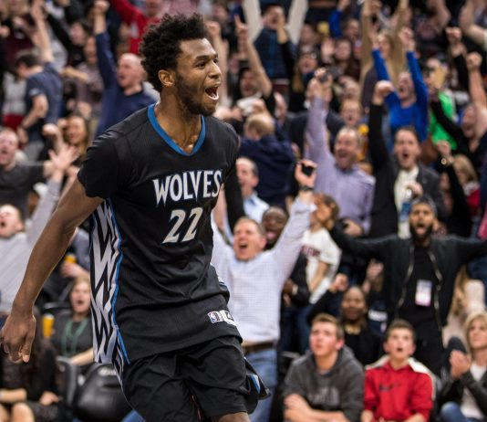 Feb 14, 2017; Minneapolis, MN, USA; Minnesota Timberwolves forward Andrew Wiggins (22) celebrates during the third quarter against the Cleveland Cavaliers at Target Center. The Cavaliers defeated the Timberwolves 116-108. Mandatory Credit: Brace Hemmelgarn-USA TODAY Sports