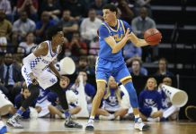 Mar 24, 2017; Memphis, TN, USA; UCLA Bruins guard Lonzo Ball (2) controls the ball against Kentucky Wildcats guard De'Aaron Fox (0) in the first half during the semifinals of the South Regional of the 2017 NCAA Tournament at FedExForum. Mandatory Credit: Nelson Chenault-USA TODAY Sports