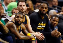 May 19, 2017; Boston, MA, USA; Cleveland Cavaliers guard Kyrie Irving (left), forward Kevin Love (center) and forward LeBron James (right) look on from the bench during the second half against the Boston Celtics in game two of the Eastern conference finals of the NBA Playoffs at TD Garden. Mandatory Credit: Winslow Townson-USA TODAY Sports