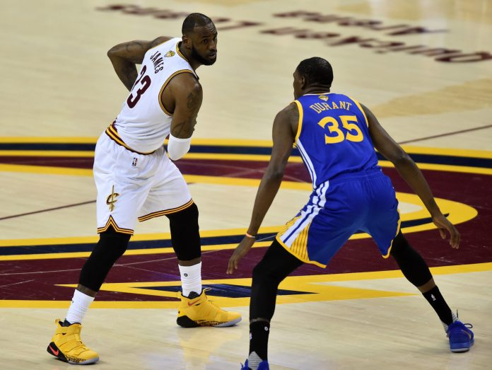 Jun 9, 2017; Cleveland, OH, USA; Cleveland Cavaliers forward LeBron James (23) handles the ball against Golden State Warriors forward Kevin Durant (35) during the first quarter in game four of the Finals for the 2017 NBA Playoffs at Quicken Loans Arena. Mandatory Credit: Ken Blaze-USA TODAY Sports