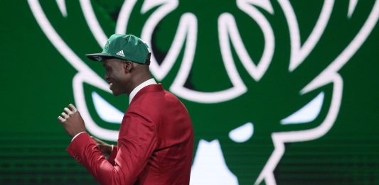 Jun 23, 2016; New York, NY, USA; Thon Maker walks to the stage after being selected as the number ten overall pick to the Milwaukee Bucks in the first round of the 2016 NBA Draft at Barclays Center. Mandatory Credit: Brad Penner-USA TODAY Sports