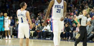 Jan 13, 2017; Philadelphia, PA, USA; Philadelphia 76ers center Joel Embiid (21) and guard T.J. McConnell (1) react as time winds down on a victory against the Charlotte Hornets at Wells Fargo Center. The Philadelphia 76ers won 102-93. Mandatory Credit: Bill Streicher-USA TODAY Sports
