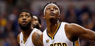 Mar 8, 2017; Indianapolis, IN, USA; Indiana Pacers center Myles Turner (33) and forward Paul George (13) block out for a rebound against the Detroit Pistons at Bankers Life Fieldhouse. Mandatory Credit: Brian Spurlock-USA TODAY Sports