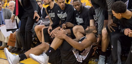 May 14, 2017; Oakland, CA, USA; San Antonio Spurs forward Kawhi Leonard (2) reacts after an injury during the third quarter in game one of the Western conference finals of the 2017 NBA Playoffs against the Golden State Warriors at Oracle Arena. The Warriors defeated the Spurs 113-111. Mandatory Credit: Kyle Terada-USA TODAY Sports