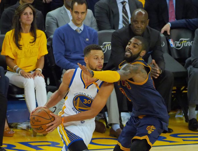 Jun 1, 2017; Oakland, CA, USA; Golden State Warriors guard Stephen Curry (30) is defended by Cleveland Cavaliers guard Kyrie Irving (2) in the second half of the NBA Finals at Oracle Arena. Mandatory Credit: Kelley L Cox-USA TODAY Sports