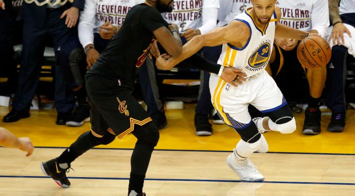Jun 12, 2017; Oakland, CA, USA; Golden State Warriors guard Stephen Curry (30) drives to the basket against Cleveland Cavaliers guard Kyrie Irving (2) during the third quarter in game five of the 2017 NBA Finals at Oracle Arena. Mandatory Credit: Cary Edmondson-USA TODAY Sports