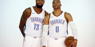 Sep 25, 2017; Oklahoma City, OK, USA; Oklahoma City Thunder forward Paul George (13) and Oklahoma City Thunder guard Russell Westbrook (0) pose for photos during the Oklahoma City Thunder Media Day at Chesapeake Energy Arena. Mandatory Credit: Mark D. Smith-USA TODAY Sports