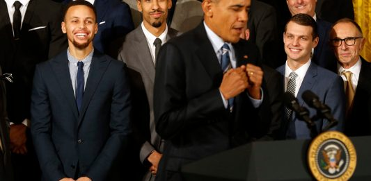 Feb 4, 2016; Washington, DC, USA; President Barack Obama (M) imitates a celebration dance of Golden State Warriors guard Stephen Curry (M) while speaking during a ceremony honoring the 2015 NBA Champion Warriors in the East Room at the White House. Mandatory Credit: Geoff Burke-USA TODAY Sports