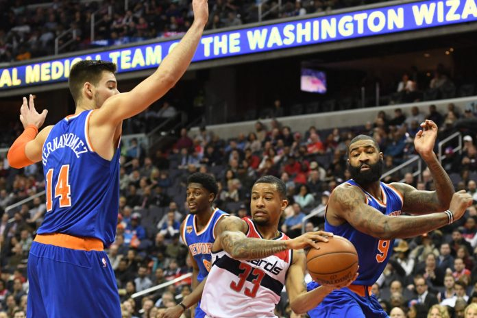 Jan 31, 2017; Washington, DC, USA; Washington Wizards guard Trey Burke (33) looks to pass inbetween New York Knicks center Willy Hernangomez (14) and center Kyle O'Quinn (9) during the fourth quarter at Verizon Center. Washington Wizards defeated New York Knicks 117-101. Mandatory Credit: Tommy Gilligan-USA TODAY Sports