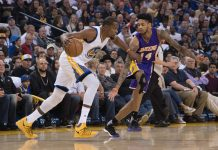 April 12, 2017; Oakland, CA, USA; Golden State Warriors forward Kevin Durant (35) dribbles the basketball against Los Angeles Lakers forward Brandon Ingram (14) during the first quarter at Oracle Arena. The Warriors defeated the Lakers 109-94. Mandatory Credit: Kyle Terada-USA TODAY Sports