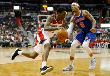 Oct 6, 2017; Washington, DC, USA; Washington Wizards guard Sheldon Mac (9) dribbles the ball as New York Knicks forward Michael Beasley (8) defends during the second half at Captial One Arena. The Wizards won 104-100. Mandatory Credit: Amber Searls-USA TODAY Sports