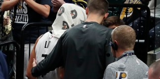 Oct 18, 2017; Indianapolis, IN, USA; Brooklyn Nets guard Jeremy Lin (7) is helped to the locker room after getting hurt in the 4th quarter against the Indiana Pacers at Bankers Life Fieldhouse. Mandatory Credit: Brian Spurlock-USA TODAY Sports