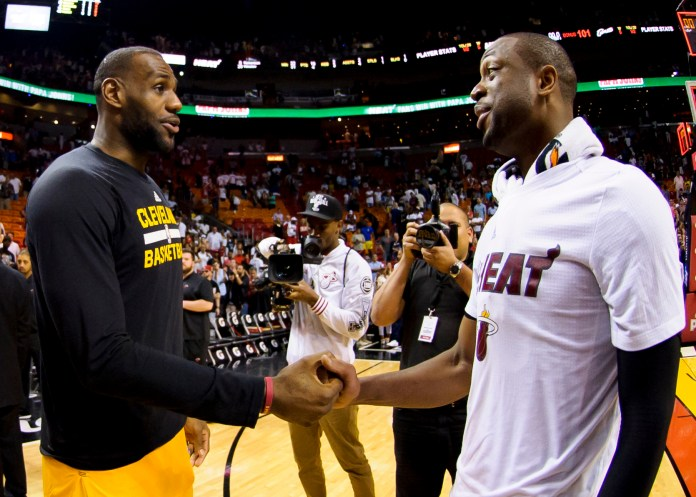 Mar 19, 2016; Miami, FL, USA; Cleveland Cavaliers forward LeBron James (left) talks with Miami Heat guard Dwyane Wade (right) after their game at American Airlines Arena. The Heat won 122-101. Mandatory Credit: Steve Mitchell-USA TODAY Sports