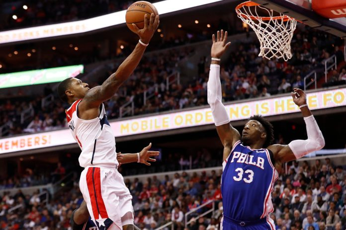 Oct 18, 2017; Washington, DC, USA; Washington Wizards guard Bradley Beal (3) shoots the ball over Philadelphia 76ers forward Robert Covington (33) in the third quarter at Capital One Arena. The Wizards won 120-115. Mandatory Credit: Geoff Burke-USA TODAY Sports