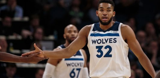 Oct 24, 2017; Minneapolis, MN, USA; Minnesota Timberwolves center Karl-Anthony Towns (32) high fives a teammate in the first quarter against the Indiana Pacers at Target Center. Mandatory Credit: Brad Rempel-USA TODAY Sports