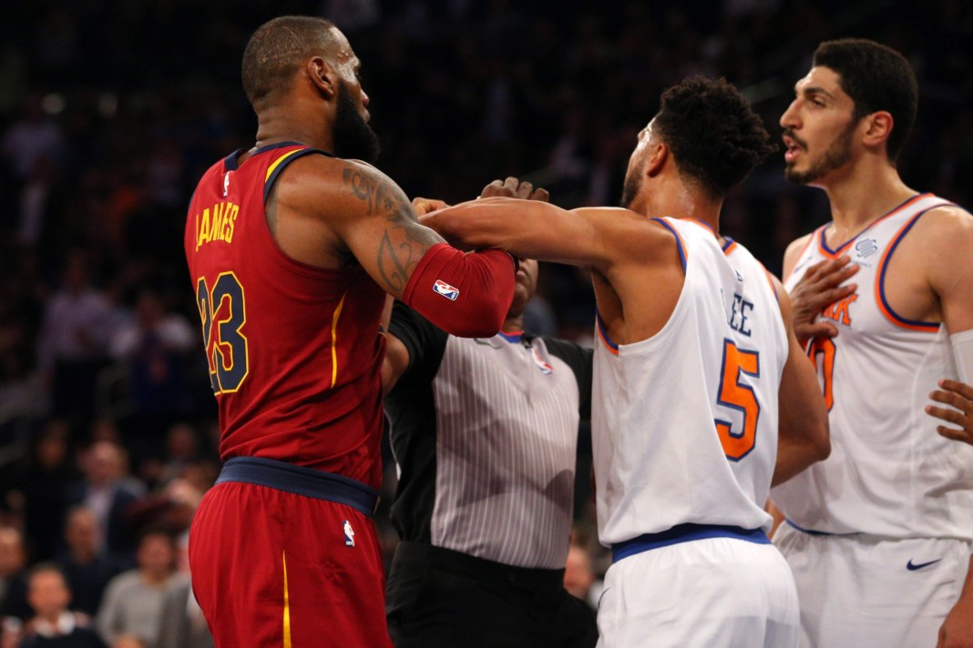 Nov 13, 2017; New York, NY, USA; Cleveland Cavaliers small forward LeBron James (23) and New York Knicks center Enes Kanter (00) are separated by New York Knicks shooting guard Courtney Lee (5) during the first quarter at Madison Square Garden. Mandatory Credit: Brad Penner-USA TODAY Sports