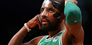 Nov 14, 2017; Brooklyn, NY, USA; Boston Celtics point guard Kyrie Irving (11) adjusts his face mask during the first quarter against the Brooklyn Nets at Barclays Center. Mandatory Credit: Brad Penner-USA TODAY Sports