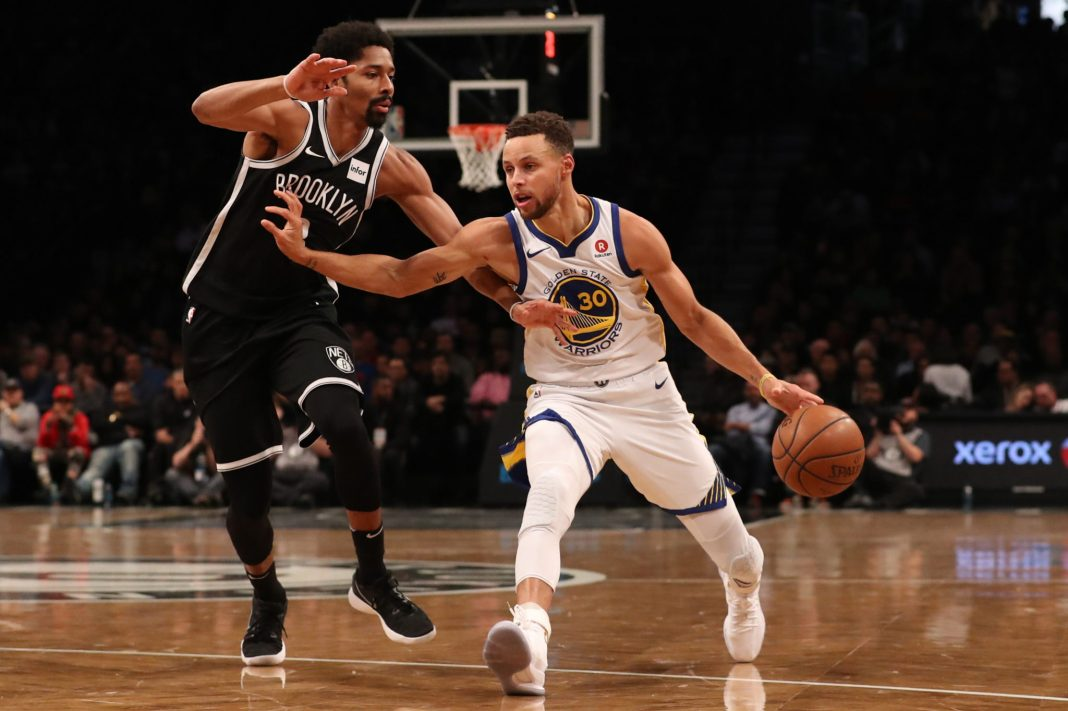 Nov 19, 2017; Brooklyn, NY, USA; Golden State Warriors guard Stephen Curry (30) holds off Brooklyn Nets guard Spencer Dinwiddie (8) during the second quarter at Barclays Center. Mandatory Credit: Anthony Gruppuso-USA TODAY Sports