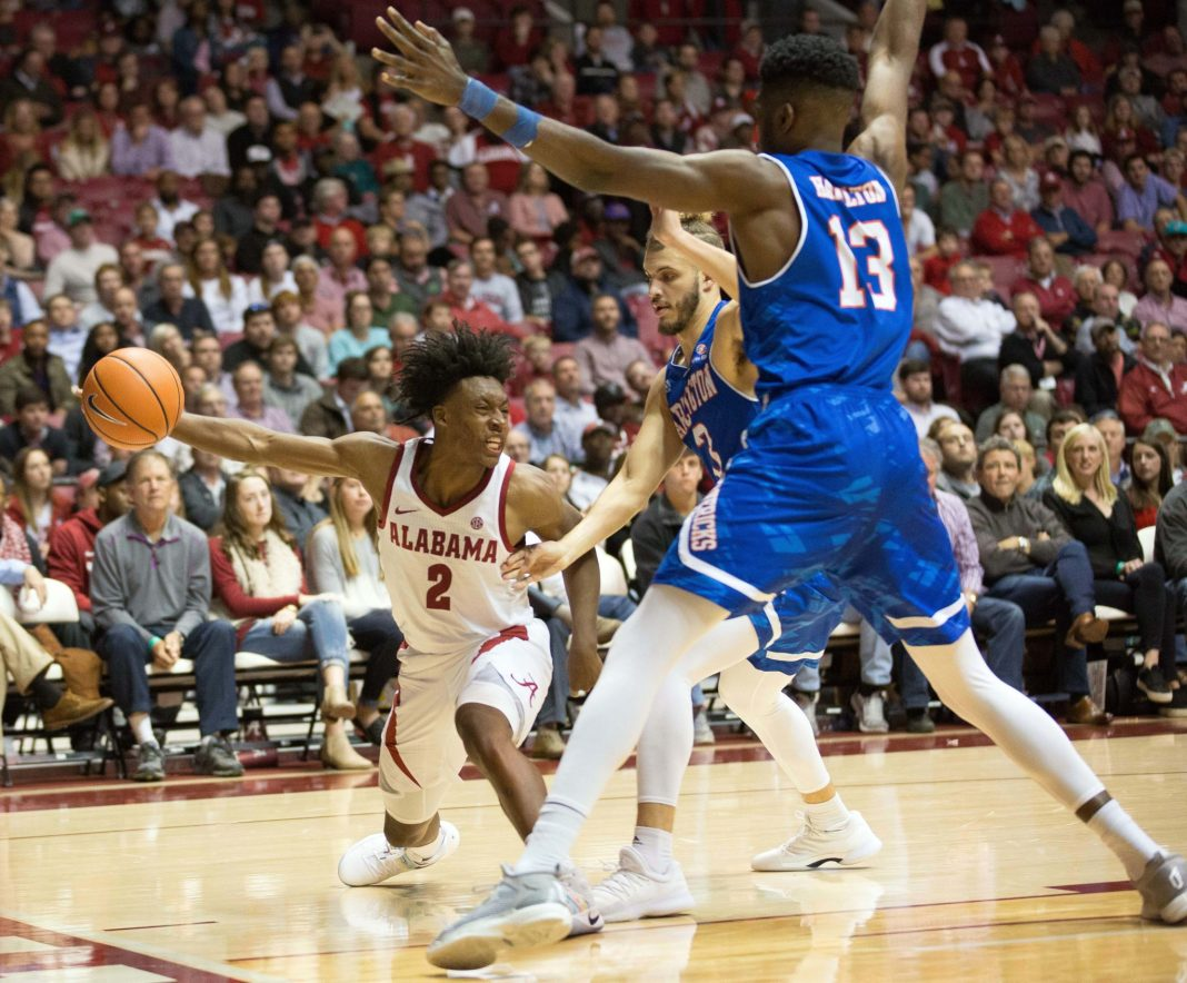 Nov 21, 2017; Tuscaloosa, AL, USA; Alabama Crimson Tide guard Collin Sexton (2) looks to pass the ball against Texas-Arlington Mavericks guard Nathan Hawkins (3) and Texas-Arlington Mavericks center Johnny Hamilton (13) during the second half at Coleman Coliseum. Mandatory Credit: Marvin Gentry-USA TODAY Sports