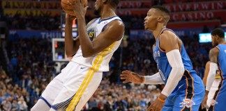 Nov 22, 2017; Oklahoma City, OK, USA; Golden State Warriors forward Kevin Durant (35) controls the ball in front of Oklahoma City Thunder guard Russell Westbrook (0) during the second quarter at Chesapeake Energy Arena. Mandatory Credit: Mark D. Smith-USA TODAY Sports