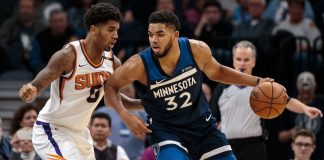 Nov 26, 2017; Minneapolis, MN, USA; Minnesota Timberwolves center Karl-Anthony Towns (32) dribbles in the third quarter against the Phoenix Suns forward Marquese Chriss (0) at Target Center. Mandatory Credit: Brad Rempel-USA TODAY Sports