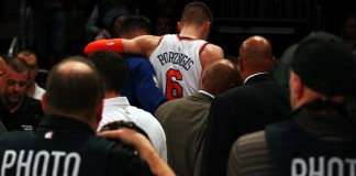 Nov 29, 2017; New York, NY, USA; New York Knicks center Kristaps Porzingis (6) is helped off the court after being injured against Miami Heat during the first half at Madison Square Garden. Mandatory Credit: Andy Marlin-USA TODAY Sports